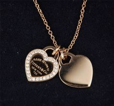 <Why love> from Burberry for Christmas Return to Tiffany? mini double heart tag pendant in silver with enamel finish.