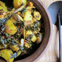 Chicken Stir Fry with Potato, Cashews, and Curry Leaves Recipe Main Dishes with waxy potatoes, canola oil, kosher salt, mustard seeds, cumin seed, green chilies, ground turmeric, onions, curry, unsalted butter, cashew nuts, boneless, skinless chicken breast