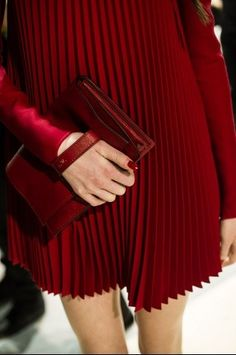 Valentino - red pleated dress and red clutch - F/W 2013