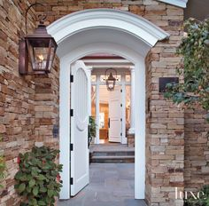 LOVE this stone exterior and this front door and the lantern!  <3  <3  <3