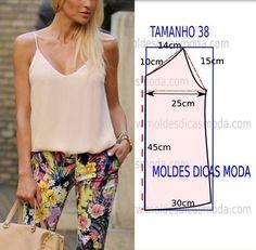 Faça a analise de forma detalhada do desenhe do molde de blusa. Blusa simples e bela, veste de forma descontraída e elegante. As medidas correspondem ao tamanho 38. A ilustração do molde de blusa não