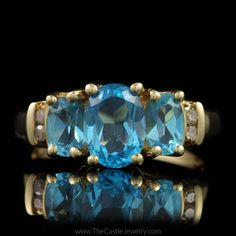 Oval Blue Topaz 3 Stone Ring with Channel Set Diamond Accents in 10K Yellow Gold