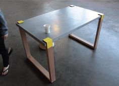 Below are some images of a table which I designed. The table top is casted concrete. The timber legs are hoop Concrete Table Top, Concrete Dining Table, Timber Table, Concrete Stone, Dining Table Legs, Concrete Design, A Table, Diy Concrete, Wood Desk