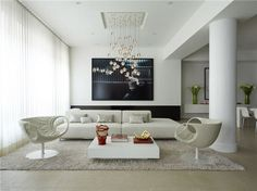 love the fluffy rugs, mod white leather, and light fixtures. yay!