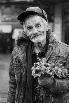 Simplicity of a warm heart…shows in his face and his flowers