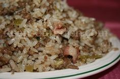 Authentic dirty rice usually contains gizzards & livers, or some other form of giblets, but don't fret if you don't like them. You can simply increase the beef or pork and still have a wonderful meal. Take it easy on the Cajun seasoning though - add a little, taste and adjust!