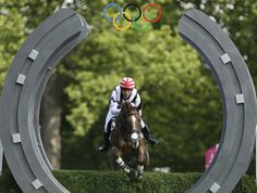 Toshiyuki Tanaka, of Japan, rides her horse Marquis De Plescop as she competes in the equestrian eventing cross-country stage at the 2012 Summer Olympics, Monday, July 30, 2012, in London.