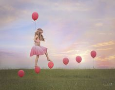 Follow your happy - composite of little girl walking on balloons