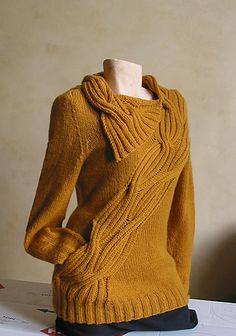 Wrapped pullover sweater pattern by Atelier Alfa with secret pocket worked into the edge of the cabling on Ravelry
