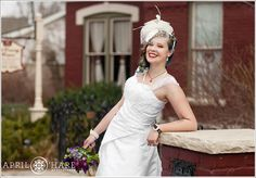 The bride poses in front of the McCreery House in Loveland Colorado at her spring wedding in Northern Colorado- April O'Hare Photography #Colorado #ColoradoWedding #ColoradoWeddingPhoto #LovelandWedding #Loveland #LovelandWeddingPhoto #Steampunk #SteampunkWedding #Springwedding #McCreeryHouse