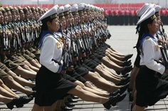 Female sailors and soldiers hold machine guns during North Korean military procession The Daily Mail