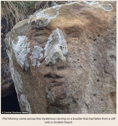 Mysterious Face Discovered Carved on Boulder in Scotland - The face, discovered by Phil McInroy as he searched for fossils close to St Andrews East Sand beach, was covered by moss and lichens and blended in with the surrounding rock. Douglas Spiers, archaeologist for the Fife Council, Glenrothes, examined the rock and stated there had been no previous records of this find