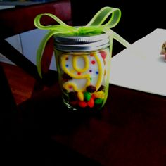 Fun way to give a gift card.  Candle, skittles, and the gift card in a mason jar wrapped w/ ribbon!!!