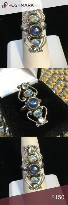 Amazing !  Kyanite & Rainbow Moonstone Ring This little work of art has Grade A genuine gemstones,  The Kyanite has that beautiful desirable opalescence !  Then the fabulous rainbow Moonstone literally glows with iridescence like it's alive !  The topped off with genuine blue topaz set in .925 Gems & Minerals Jewelry Rings