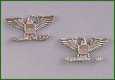Colonel insignia by ANS. $8.99. Military Colonel's Eagles Rank Emblems polished silver toned metal. Set of two.