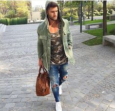 Camo and ripped jeans with super loose green hooded sweater.