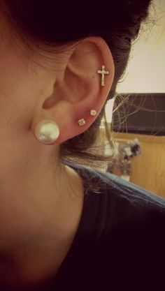 I like the cross piercing but I don't know if I would want the third piercing on the bottom.