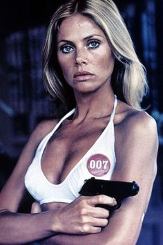 Britt Ekland as Mary Goodnight in The Man with the Golden Gun - True to '70s style, Britt's look in The Man with the Golden Gun was a prime example of California-girl beauty—aka bouncy blonde locks and glowing bronze skin.