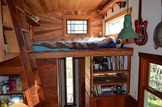 Loft of cabin made from salvaged materials: small spaces can be beautiful.