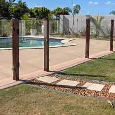 Cool way to make a modern glass pool fence less modern. You could get the glass etched with a picture or something as well (like a gumleaf) to tie it in with an existing patio fence.