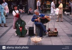 Street Entertainers Munich Germany Stock Photo Munich Germany, Orchestra, Musicals, Coding, Entertaining, Stock Photos, Street, Concert, Fun