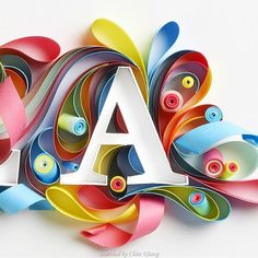 Full of fun to round out Quilling by in Mumbai. Love the paper rolls ending on an angle. Arte Quilling, Quilling Letters, Paper Quilling Patterns, Quilling Paper Craft, Quilling Cards, Paper Crafts, Quilling Work, Origami, Quilling Tutorial