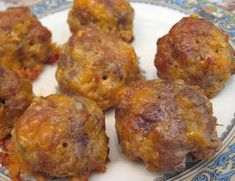 Low Carb Breakfast Balls - might try this with an even amt of sausage & beef, or reverse the quantities--more beef than sausage. Also, using half cheddar and half Three Alarm Cheese would give some real kick.