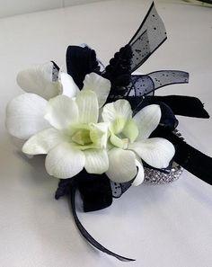 White dendrobium orchids wrist corsage