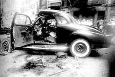 Above: In August of 1937, Purple Gang member Harry Millman's LaSalle Coupe was blown to bits. The blast killed a valet (who had been sent for the coupe) outside the 1040 Club in Detroit, a favourite Purple Gang watering hole. photo: The Detroit News