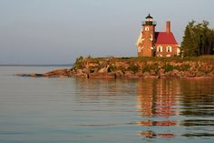 Great Lake Lighthouse: Sand Island Lighthouse, Apostle Islands---Sand Island is the westernmost of the Apostle Islands. You often times see the lighthouse keeper waving from the tower!