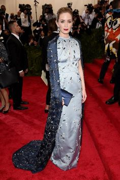 Emily Blunt in Prada. Emily Blunt took this year's theme really seriously in an Asia-inspired light blue gown and navy blue cape for dramatic flair.