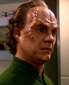 Dr. Phlox, Star Trek: Enterprise, played by John Billingsley. He had the nicest bedside manner of any fictional doctor that comes to mind! :)