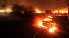 A car is engulfed in flames as the Valley fire spots over Highway 29 in Middletown,Calif., Saturday, Sept. 12, 2015. (Kent Porter/The Press Democrat via AP) Photo: Kent Porter, Associated Press