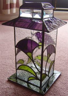 purple and clear stained glass lantern with flowers Stained Glass Light, Stained Glass Suncatchers, Stained Glass Flowers, Stained Glass Designs, Stained Glass Panels, Stained Glass Projects, Stained Glass Patterns, Leaded Glass, Mosaic Glass