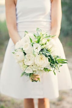 The bridal bouquet will be a clutch of cream hydrangeas, ivory garden roses, white lisianthus, white scabiosa, jasmine vine, and white freesia wrapped in ivory ribbon with a bow.