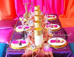 Table decorations and bright colors in fuchsia, blue, and purple
