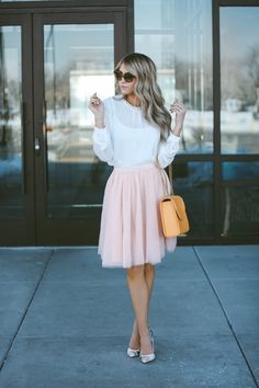 Cara Loren looks effortlessly feminine in this pale pink tulle skirt, worn with a sheer white blouse and a pair of petite matching heels. Keeping this look pastel coloured can be very effective, as seen through the combination of colours Cara has chosen for her outfit.   Jacket: Windsor Store, Skirt: Asos.