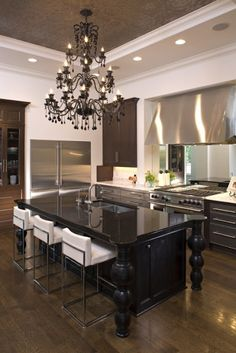 Chandelier, stainless steel, ceiling details, black island & white barstools