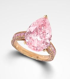 Pink Pear Shape Cut - GRAFF's Signature Style ring features an exquisitely rare Pink Pear shape diamond upon a delicate pavè band of rare pink diamonds -  the ultimate bridal rarity