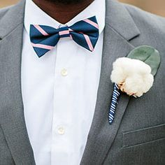 Navy-and-Pink-Striped Bow Tie - Bow Ties for Dapper Southern Gents - Southernliving. A striped navy-and-pink bow tie manages to look business-like and fun at the same time! We love how this groomsman achieves a timeless look with a dash of color.     See more: Magnolia Texas Wedding