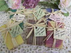 50 mini soaps ready for your bridal shower favors. All natural handmade soaps. Good for a birthday party, a bridal shower, wedding favors, baby shower, club event, etc.    Adorned with raffia and a tag with your personalized message. Please place order at least 3-4 weeks in advance.  ************************************************************  *****RUSH ORDERS**** RUSH ORDERS - 1-2 WEEKS DEADLINE. YOU MUST CONTACT ME FIRST***** BEFORE YOU BUY,********** PLEASE. DUE TO THE AMOUNT OF ORDERS I…