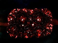 Loving our rich red fall floral clutch...
