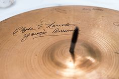 In lieu of a traditional guestbook, Emily and Dean asked their guests to sign a cymbal. So creative! {Photo by Kim Schepperley via Project Wedding}