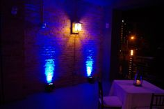 Blue outdoor uplighting on the balcony at The Venue in Asheville