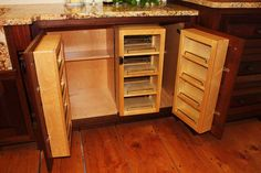 Handcrafted Custom Kitchen Cabinetry - If you have really deep cabinets, you can insert multiple shallow shelf units inside to be able to get to everything and not have to dig to the back of the cupboard!     Shallow shelves mounted on the inside of the doors ... as well as another set mounted on piano hinges in front of the cupboard shelves, (so you can flip them 180 degrees out of the way and get to the back shelves when needed) holds A LOT of stuff and gives you easy access to all items.