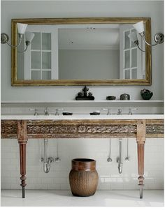All Remodelista Home Inspiration Stories in One Place Wide mirror for double sink A carved sink console in a bath from the portfolio of Monica Bach. Master Bathroom Vanity, Wood Bathroom, Bathroom Ideas, Bathroom Vanities, Bathroom Renovations, Washroom, Bathroom Cabinets, Wood Cabinets, White Bathroom