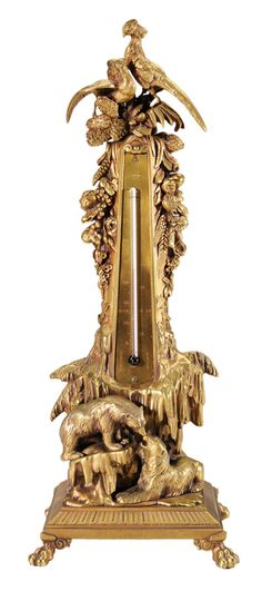 "French, early 20th century, marked ""Leblanc(?)"", obelisk of heavy gilt bronze construction with paw feet, ornaments representing the seasons, top with exotic birds, fruit and flowers, base with polar bears and icebergs, front mounted with thermometer, 17-1/2 in."