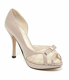 Even though I have no idea what you dress looks like.  I thought these where pretty  Caparros Hollie dOrsay Pumps #Dillards