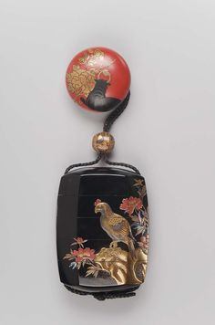 Manju netsuke with design of water-buffalo and peony | Ojime with design of toys 19th century
