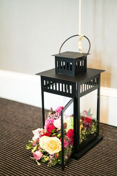 flowers spilling out of lanterns   via ruffled.com